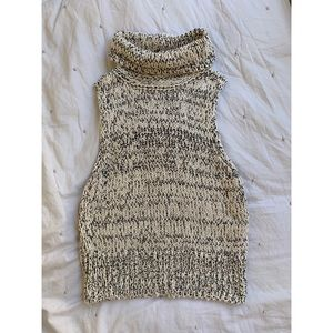 Knitted sleeveless turtle neck sweater